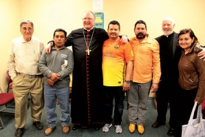 Dolan stands with farmworkers and Monsignor Kevin Sullivan (second from right).