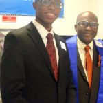 """""""It's a way to give back to the community,"""" said immigration lawyer Maurice Maitland Sr. (right), with his son."""