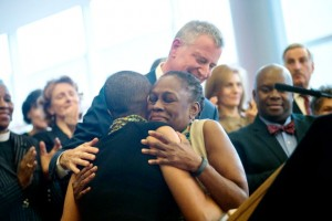 McCray embraces daughter Chiara (left) during a ThriveNYC announcement in November 2015.