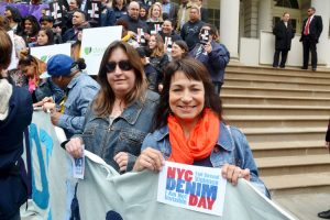 """""""It's time for healing,"""" said Gina Simo (right) with friend Heidi."""