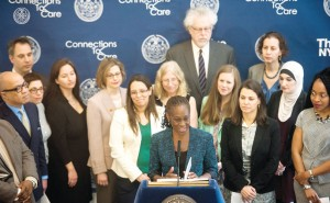 """I think it'll have an extraordinary impact,"" said First Lady Chirlane McCray (center, in green)."