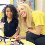 Volunteer Kate Tylis led a group in an arts and crafts project at Harlem Hospital Center.