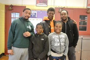 """They get to express themselves,"" Said Counselor Demetrius Dinkins (in green sweater), with participants from the Southeast Bronx Neighborhood Center's afterschool program."