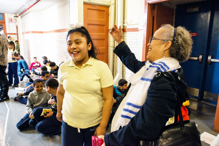 Community Health Workers Program Manager, Miriam Mejía (right) celebrates with a student. Photo: C. Vivar