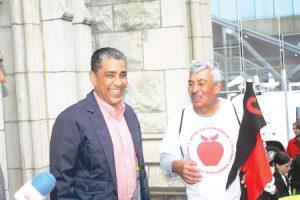 Sen. Adriano Espaillat (left) speaks with a marcher.