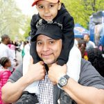 Joah, 5, hitches a ride with his father Santos.