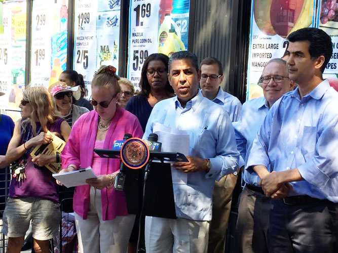 """We must fight to protect [small businesses],"" said State Senator Adriano Espaillat (center)."