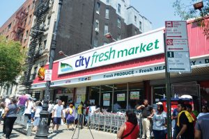 The supermarket is located on 116th Street.