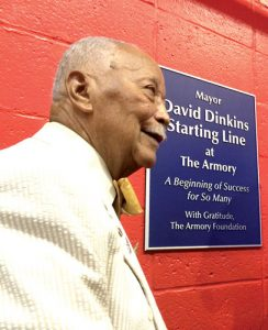 Former Mayor David Dinkins stands at the plaque marking the starting line.