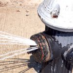 A hydrant with a spray cap releases 20 to 25 gallons per minute.