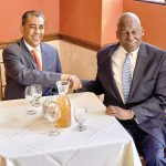 A candid handshake inside the restaurant. Photo: C. Vivar