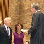 Bratton being sworn in 2014.