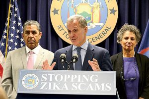 """We won't let fraudsters take advantage of a public health crisis,"" said AG Eric Schneiderman (center)."