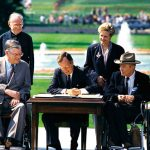 President Bush signs the Americans with Disabilities Act into law in 1990.