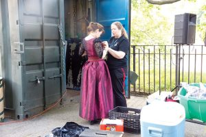 Technical Director Catherine Bruce puts the finishing touches on a costume during 2013's King Lear.