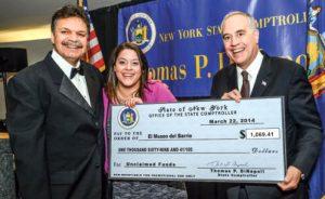 Comptroller DiNapoli presents El Museo del Barrio with a check.