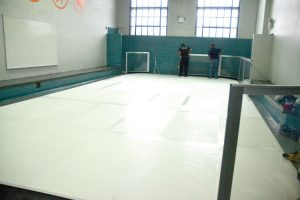The synthetic ice rink was installed within the recreation center.