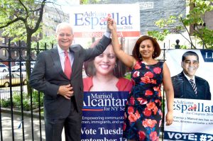 Marisol Alcántara, here on the campaign trail with Fernando Ferrer, will be headed to the State Senate.