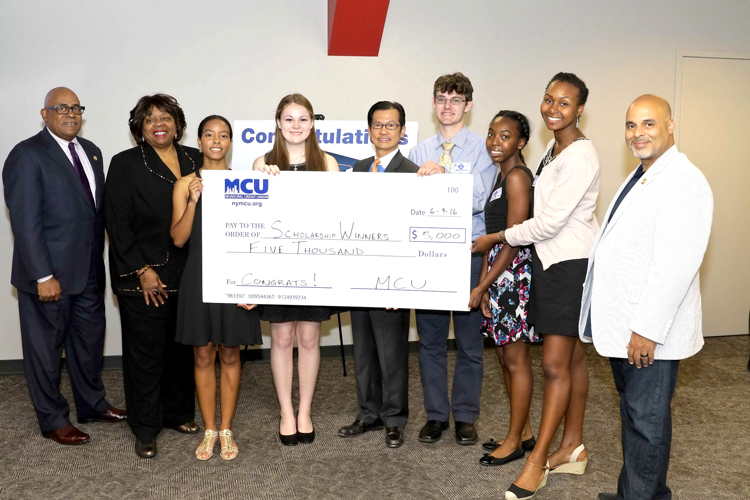 2016 scholarships were presented to the recipients by MCU President/CEO Kam Wong (center, with glasses) and Board Chair Sylvia G. Ash (second from left).