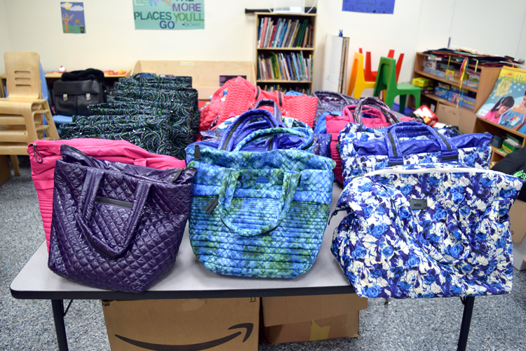 New diaper bags were offered as gifts.
