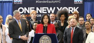 Carmelyn P. Malalis (center) is the Commissioner of the New York City Commission on Human Rights.