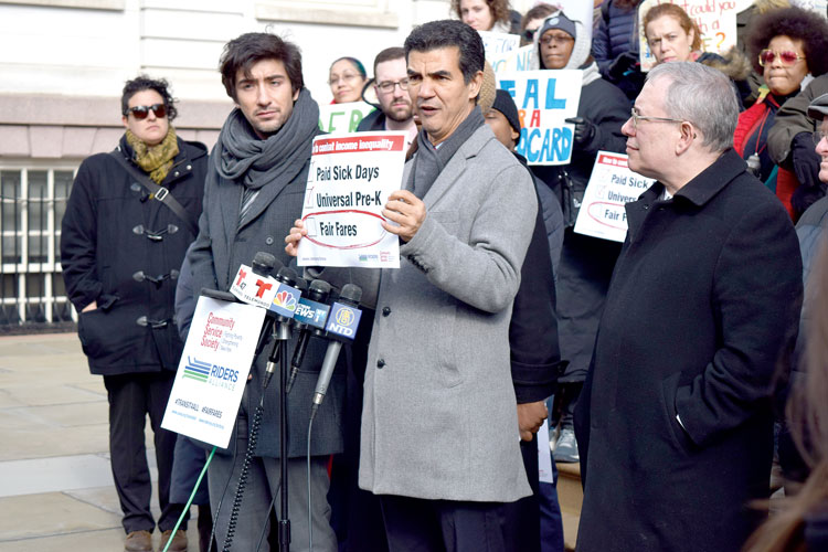 Councilmember Ydanis Rodríguez (center) spoke on income inequality.