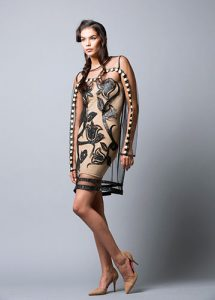 Bethany Yellowtail (Apsáalooke [Crow] and Northern Cheyenne) for B Yellowtail, Old Time Floral Elk Tooth dress, Apsáalooke Collection, 2014. Lace, leather appliqué, and elk teeth. Photo: Thosh Collins