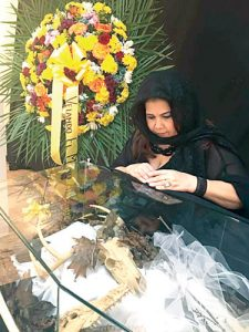 A mourner pays her respects.