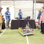Manhattan Borough President Gale Brewer (far right) observes a robot at work.