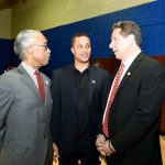 Rev. Al Sharpton (far left) with Akeem Browder and Gov. Andrew Cuomo.