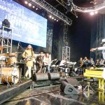 Jon Batiste (leaping on the right) performed on stage.