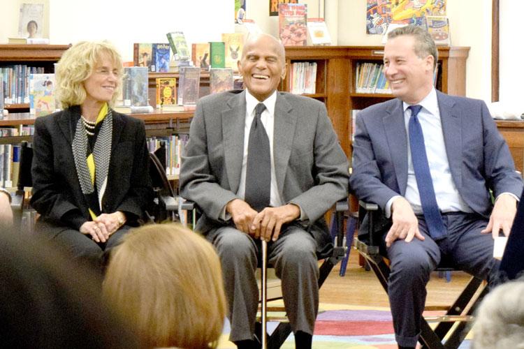 Belafonte (center) listens in.