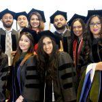 The grinning graduates.