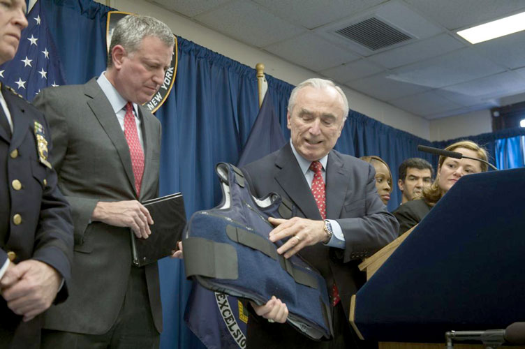 De Blasio and others unveil bullet-proof vests in 2015.