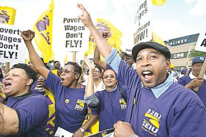Airport workers are calling for change.