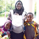 """""""It was a big help to me,"""" said Adama Sambou, here with her children, of the program."""