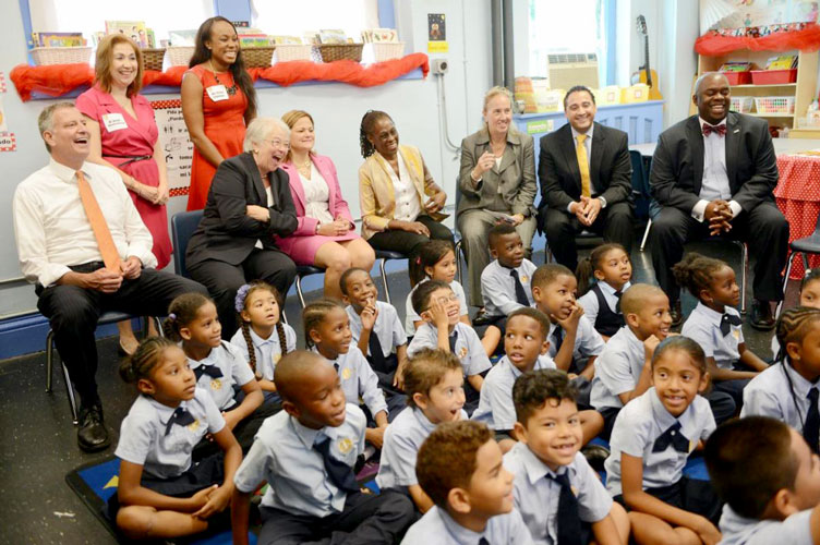 Mayor Bill de Blasio and officials visit a classroom in 2014.