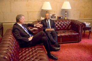 De Blasio had support from Assembly Speaker Carl Heastie (right).