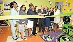 Carter participates in a ribbon-cutting ceremony a PATH Intake Center in June 2016.
