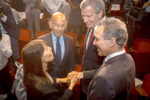 Jill Furillo, NYSNA Executive Director, and Steven M. Safyer, Montefiore Medical Center President and CEO, speak with de Blasio and Schneiderman.
