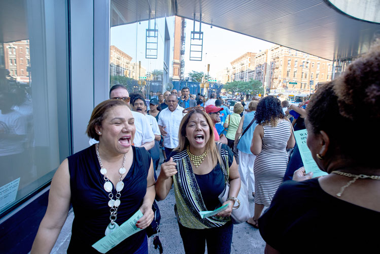 Community residents chanted in unison.
