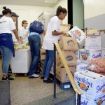 The site typically hands out more than 400 bags of food per week.