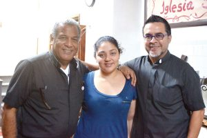 """She's building a platform that other people can stand on,"" said minister Juan Carlos Ruiz, here with Father Luis Barrios (left) and Amanda Morales-Guerra."