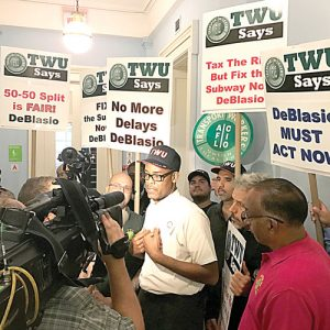 """There is a crisis now,"" said Local 100 Secretary Treasurer Earl Phillips (center). Photo: TWU"