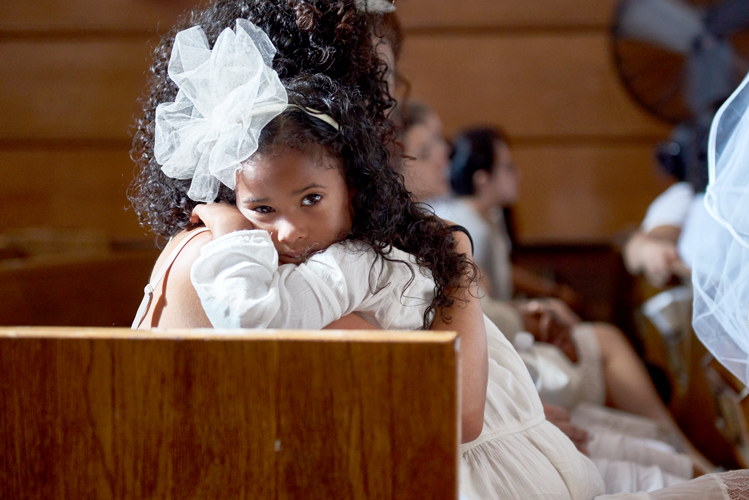 A young girl in the pews.