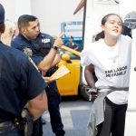A protester is arrested on Fifth Avenue.