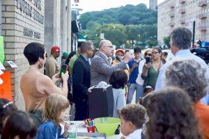 Mayoral hopeful (enter) Sal Albanese addresses the crowd.