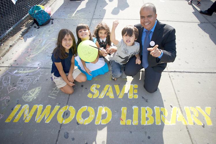 City Councilcandidate Josué Pérez poses with local children.