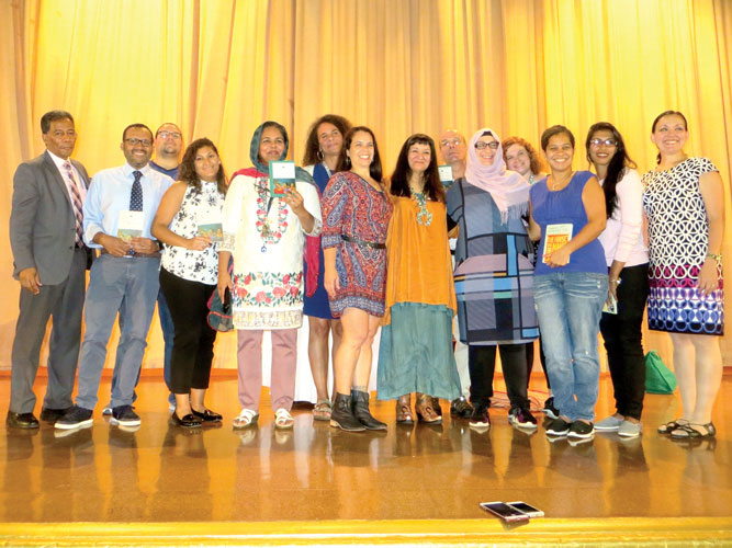 """This [is] part of our mission,"" said Principal Juan Villar (far left) with staff members."