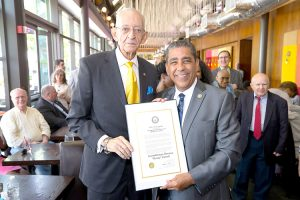Farrell is presented with a citation by Congressman Adriano Espaillat.